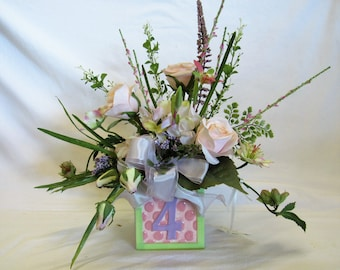 Baby Nursery Arrangement with Square Ceramic Holder with Letter C , #4, and a Giraffe and Turtle, Silk Florals and a silk and sheer bow