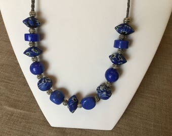 Necklace glass beads and Blue ceramic on leather.