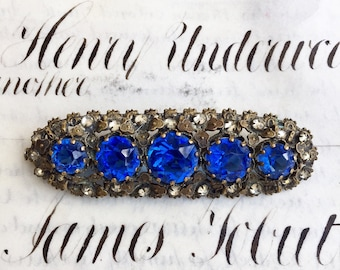 Antique French Brooch, A Remarkable and Large Costume Pin with Blue and Clear Rhinestones Set in Bronze, 19th Century