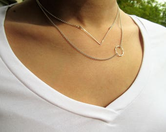 Sterling silver necklace with a wide open triangle pendant