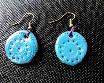 Handmade floral embossed blue round clay earrings on bronze earring hooks - a unique gift!