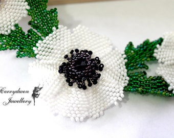 Beaded white poppies
