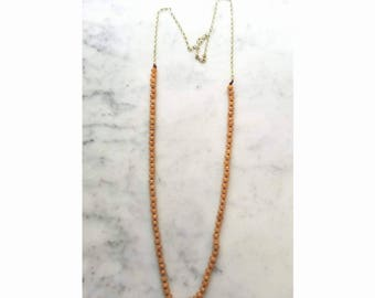 Hand knotted red aventurine with raw brass chain