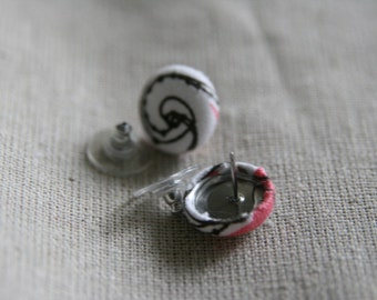 Cranberry, white, and black swirl cover button earrings.