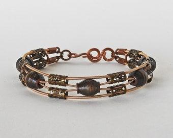 Antique Gold and Bronze - Handmade Paper Bead & Guitar String Bracelet