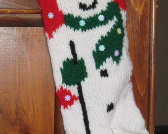 Hand-Knitted Snowman Christmas Stocking with Red Background and Sequin Snowflakes