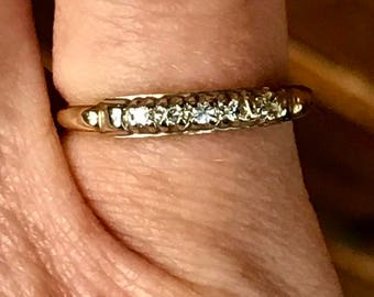 14k Gold diamond band ring.