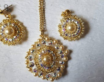 A SUNBURST 1.5 inch round gold and Swarovski Crystal rose montee pendant with matching earrings. Gold chain included.