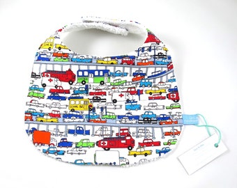 Rush Hour baby bib -  colourful traffic, trucks, cars, ambulances, school buses, fire engines on white, backed with soft, white towelling.