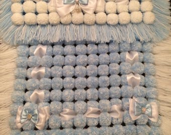 Blue and white pompom blanket for pram, car seat or Moses baskets