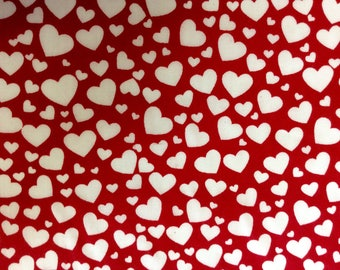 Fabric polycoto 112cm width. Pattern hearts white on red background