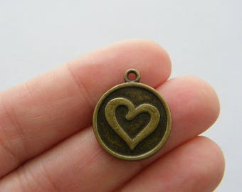8 Heart charms antique bronze tone BC53....