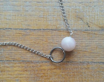 Simple gunmetal ring and pale pink bead necklace