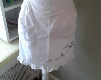 Cute white apron with embroidery....side pocket....ruffles.....back ties