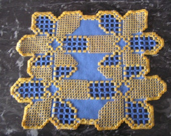 Small blue and yellow Hardanger doily