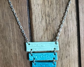 Ombre teal/turquoise texturized ceramic bars on silver plated cable chain
