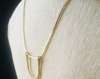 Handmade long gold chain necklace with brass horseshoe shaped pendant; simple