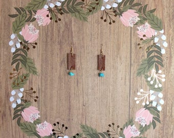 Leather earrings w/ charm