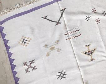 "Moroccan white cactus silk ""sabra"" rug, purple zig zag and Berber tribal designs"