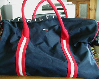 Wonderful Vintage Tommy Hilfiger duffle bag in fantastic condition.  Measures 19 inches across the bottom and top 12 inches deep on sides