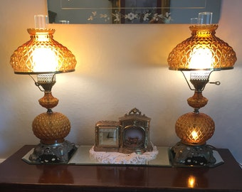 """A pair of Hedco Amber """"Gone with the Wind"""" style matching lamps from the 50s/60s"""