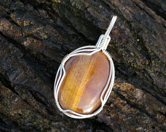 Tiger eye and sterling silver pendant