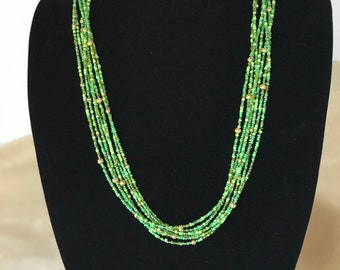 Multi strand green and gold beaded necklace