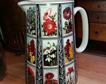 A beautiful large pitcher/jug decorated with prints of Will's cigarette cards.