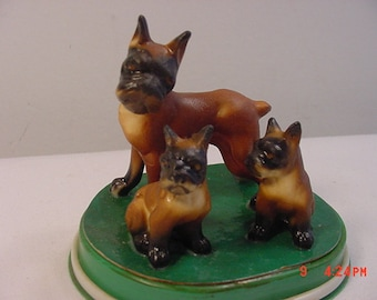 3 Vintage Ceramic Boxer Dogs On A Green Plastic Base   17 - 288