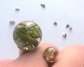Handmade ring with golden flakes and the pines of the tree spines of the Pine tree