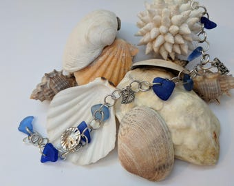 Blue sea glass bracelet with charms