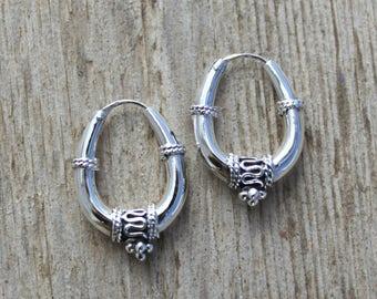 Sterling silver hoop earrings. Oval Bali hoop earrings. Bali hoop earrings. Oxidiced sterling silver earrings. Tribal hoop earrings.