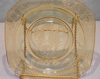 Parrot (Sylvan) Amber Depression Glass Plate, 6 in.