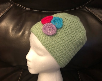 Crocheted hat with flowers. Easter colors.