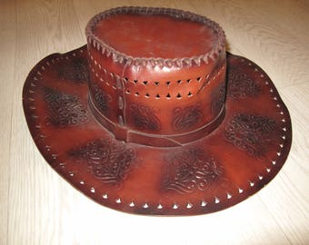 Cowboy hat, tooled leather Western style