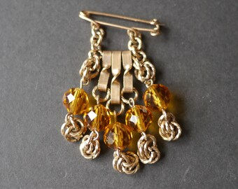 Waterfall cascade vintage beaded brooch, orange faceted glass beads and gold tone chain, on pin