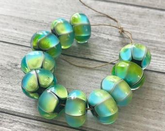 Turquoise green handmade glass bead
