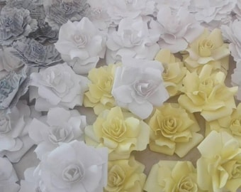 25 small mixed paper flowers of various shapes and colors