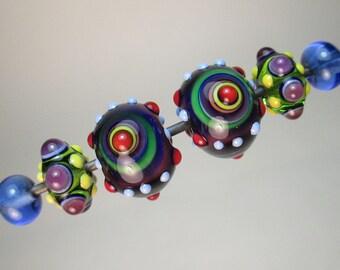 PAARWEISE: BULLSEYE Focals + Fancy Minnie und Transparent Blau Plains handgefertigte Glasperlen von Patti Cahill (insgesamt 6 Perlen)