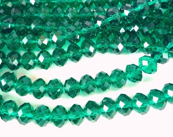 10 glass faceted beads, emerald green, 7x10mm (pv392)
