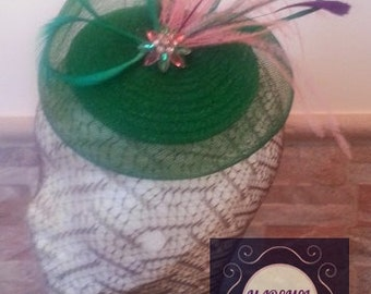 Fascinator in green and pink