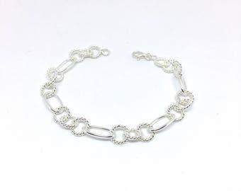 Bracelet links twisted in sterling silver.