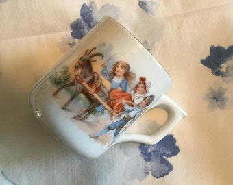 Child's China Cup with scene of children with cart pulled by a Billy goat