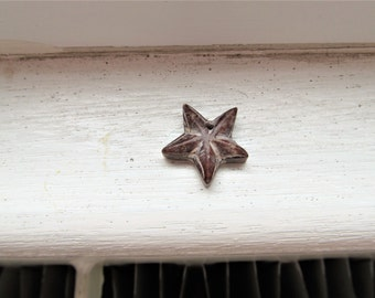 Hand Carved Star Pendant