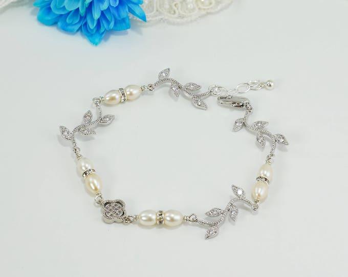 Leaf vine bracelet, freshwater pearls with cubic zirconia pave 4 leaf lucky clover, flower bracelet, blush  cream, low back, brides,
