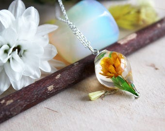 Teardrop Pendant in resin, bamboo leaf and orange small flower