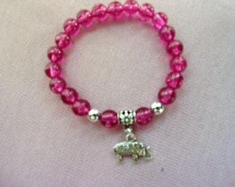 Pink stretch braclet with elephant charm