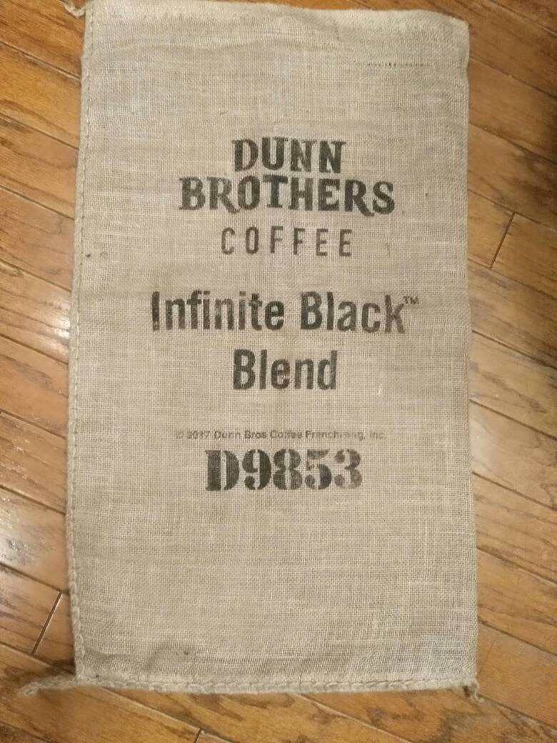 Burlap coffee bag. Upholstery craft supply wall hanging.