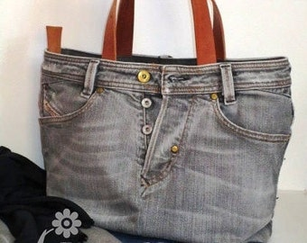 Grey denim bag with leather handles and bottom