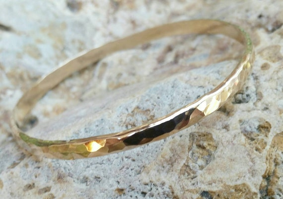 Gold Bangle Bracelet thick and wide with hammered shiny texture. Available in Gold Filled, Rose Gold Filled, 14kt Gold, or 14kt Rose Gold.
